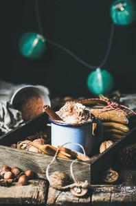 Mug of hot chocolate  garland with blue balls at background