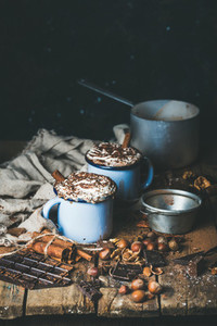 Hot chocolate with whipped cream  different nuts and spices