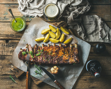 Roasted pork ribs with sauce fried potato and dark beer