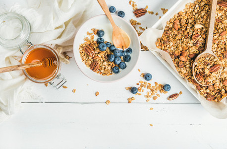 Oat granola with nuts  yogurt  honey and blueberries