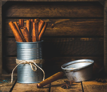 Cinnamon sticks in can tied with rope anise and sieve