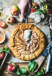 Man039s hand holding piece of homemade apple crostata pie