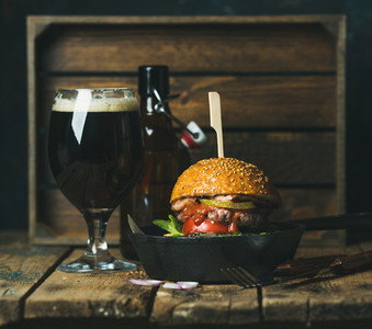 Beef burger with crispy bacon  vegetables and beer