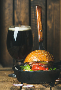 Homemade burger with vegetables and tomato sauce in small pan