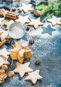 Christmas star shaped cookies with spices and fir tree branch