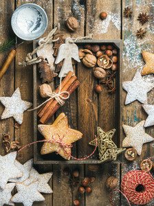 Wooden tray with cookies decorative angels and stars cinnamon nuts