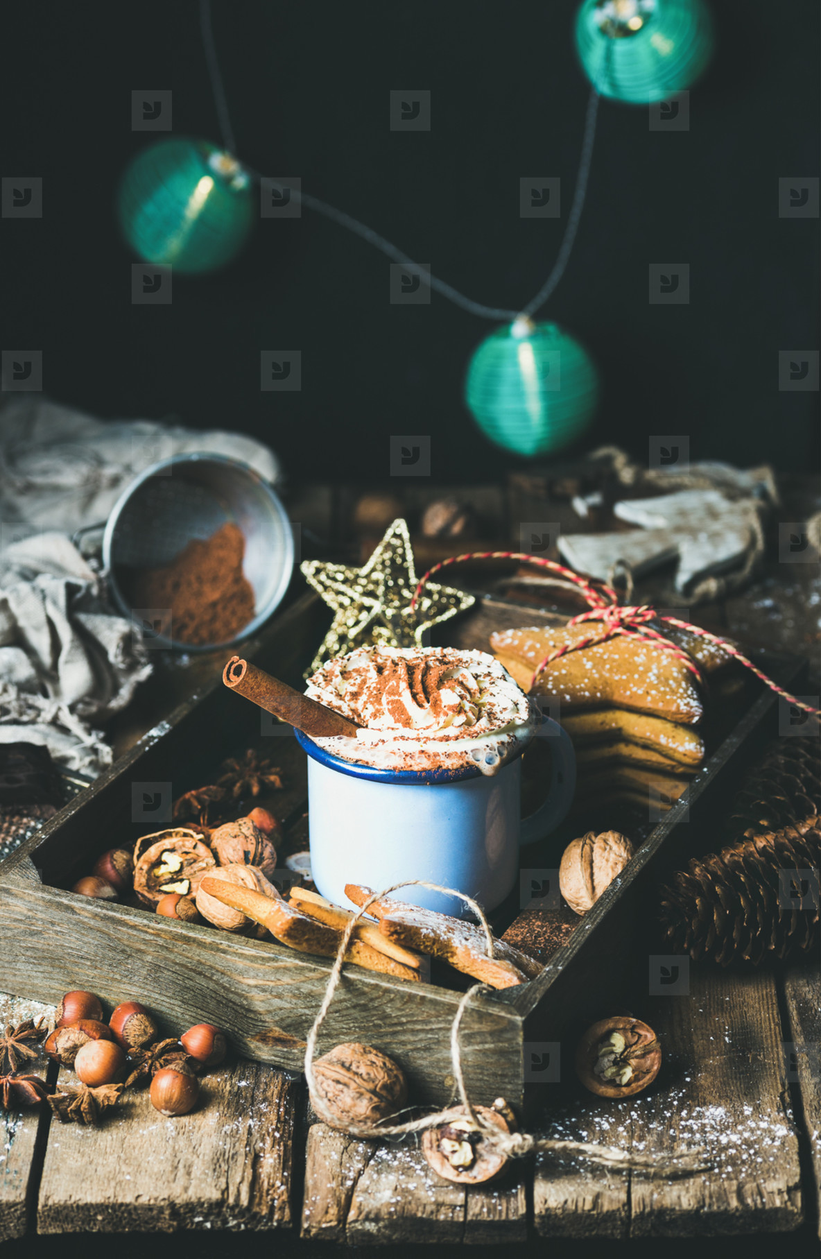 Mug of hot chocolate  garland with blue balls at background