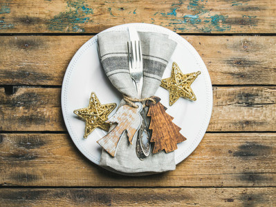 Christmas  New Year holiday table setting over rustic wooden background