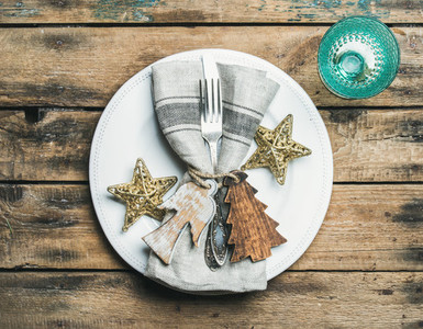 Christmas  New Year holiday table setting over wooden background