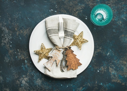 Christmas New Year holiday table setting over dark blue background