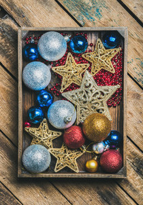 Christmas tree toy stars  balls and garland in wooden box