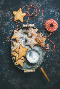 Christmas star shaped gingerbread cookies with ropes and sugar powder
