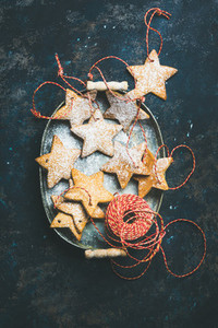 Christmas holiday star shaped gingerbread cookies over dark blue background