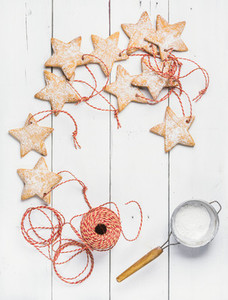 Christmas gingerbread star shaped cookies with sugar powder  red rope
