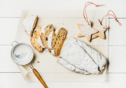 Traditional German Christmas cake Stollen cut in pieces  white background