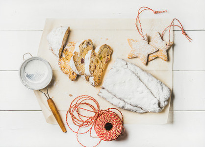 Traditional German Christmas cake Stollen cut in pieces  cookies  rope
