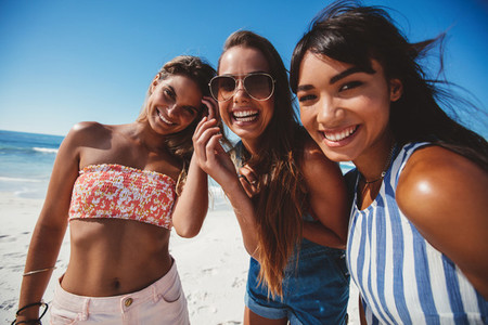 Three young women friends on beach
