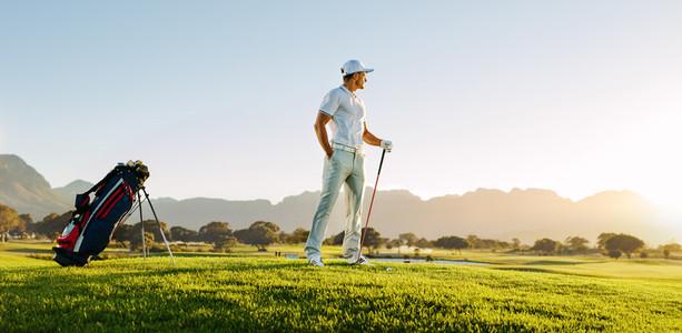Professional male golfer on field