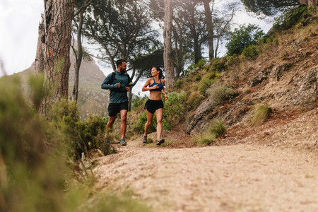 Young couple on cross country run in morning