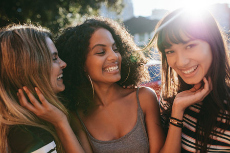 Multiracial female friends enjoying a day around the city