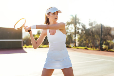 Beautiful woman playing tennis match