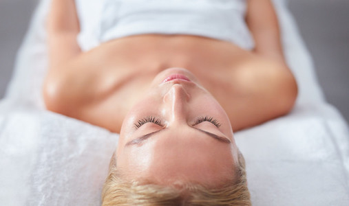 Young woman face relaxing on massage table