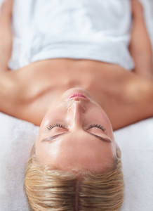 Beautiful woman waiting for massage at wellness spa