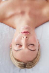 Beautiful woman on a massage table at dayspa