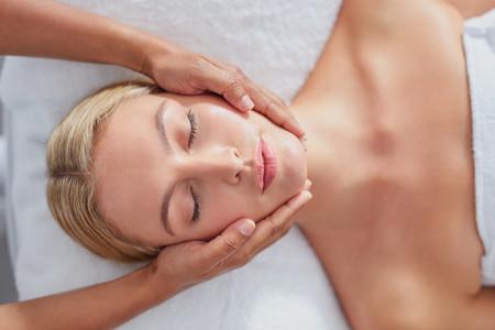 Beautiful young woman getting a facial massage
