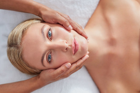 Woman enjoying beauty treatment at spa