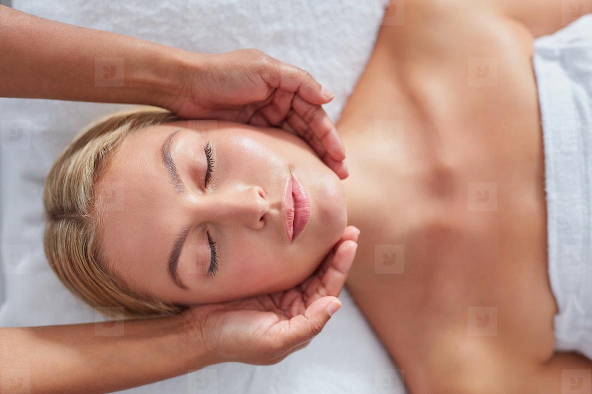 Attractive woman getting head massage at dayspa