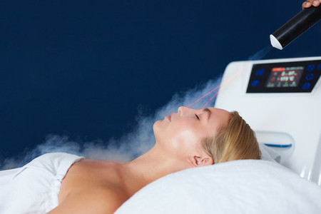 Woman receiving local cryotherapy therapy