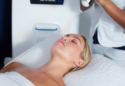 Attractive female getting local cryotherapy therapy