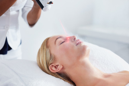 Woman undergoing local cryotherapy at spa