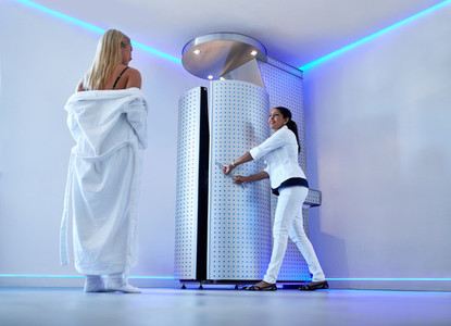 Woman taking cryosauna treatment at cosmetology clinic