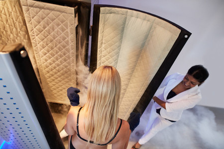 Woman entering Cryo sauna for whole body cryotherapy