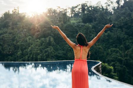 Woman enjoying tropical climate at luxury resort