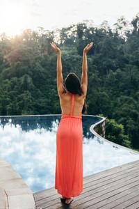 Young woman enjoying near poolside