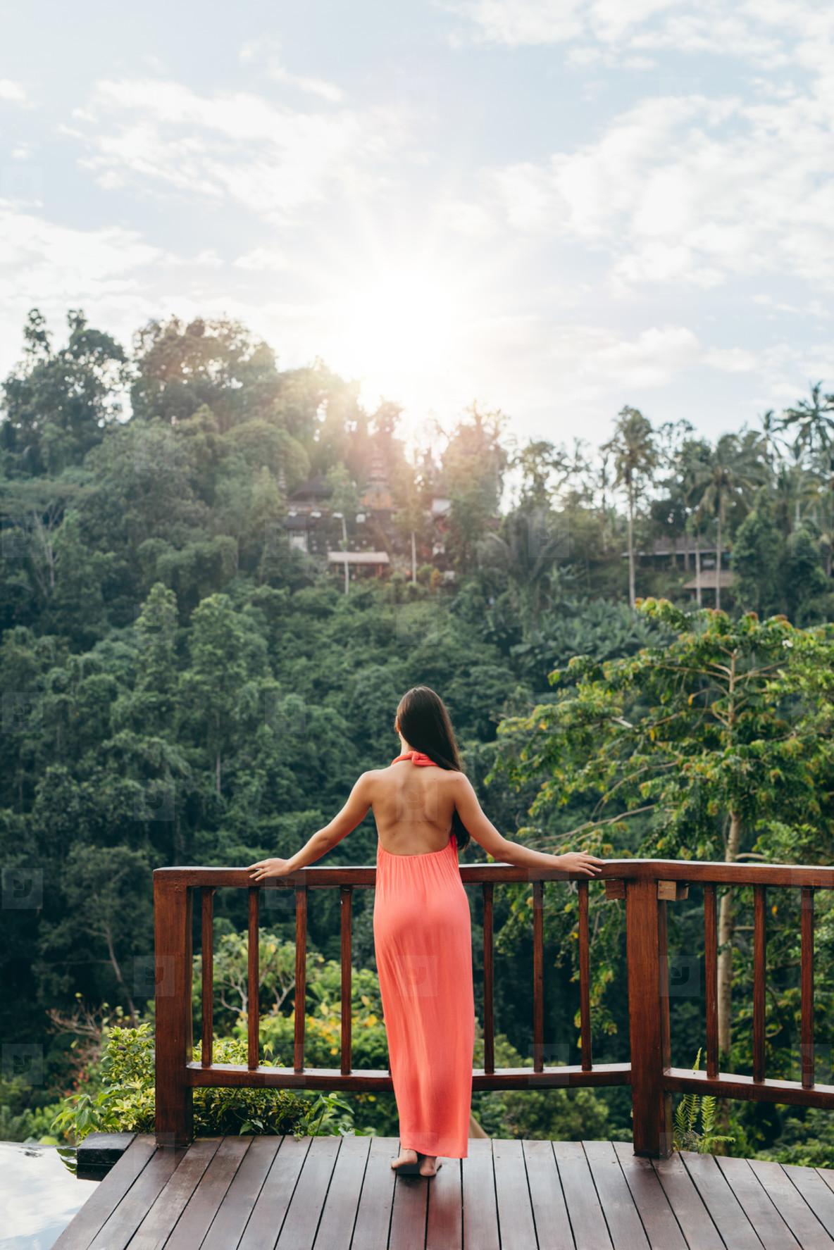 Woman at luxury resort looking at beautiful view