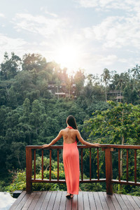 Woman at luxury resort looking at beautiful view