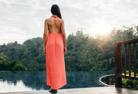 Woman at poolside of a luxury resort