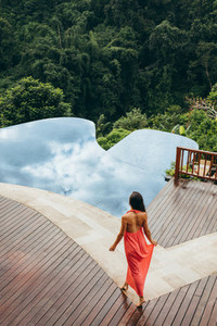 Young woman at luxury resort poolside