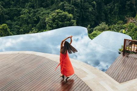 Woman enjoying her vacation at luxury resort