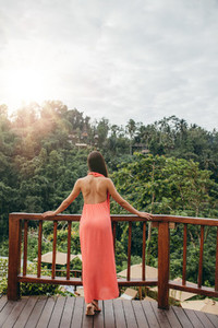 Woman standing by a railing at luxury resort