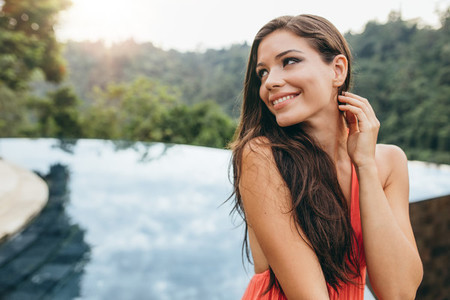 Beautiful young woman looking away and smiling