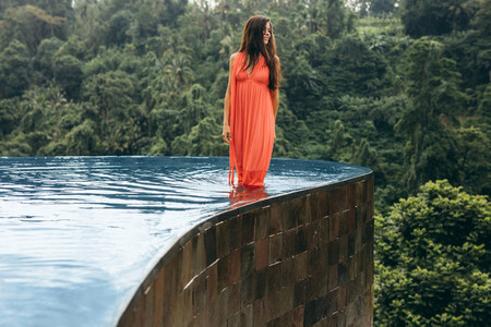 Young woman in swimming pool looking away at view