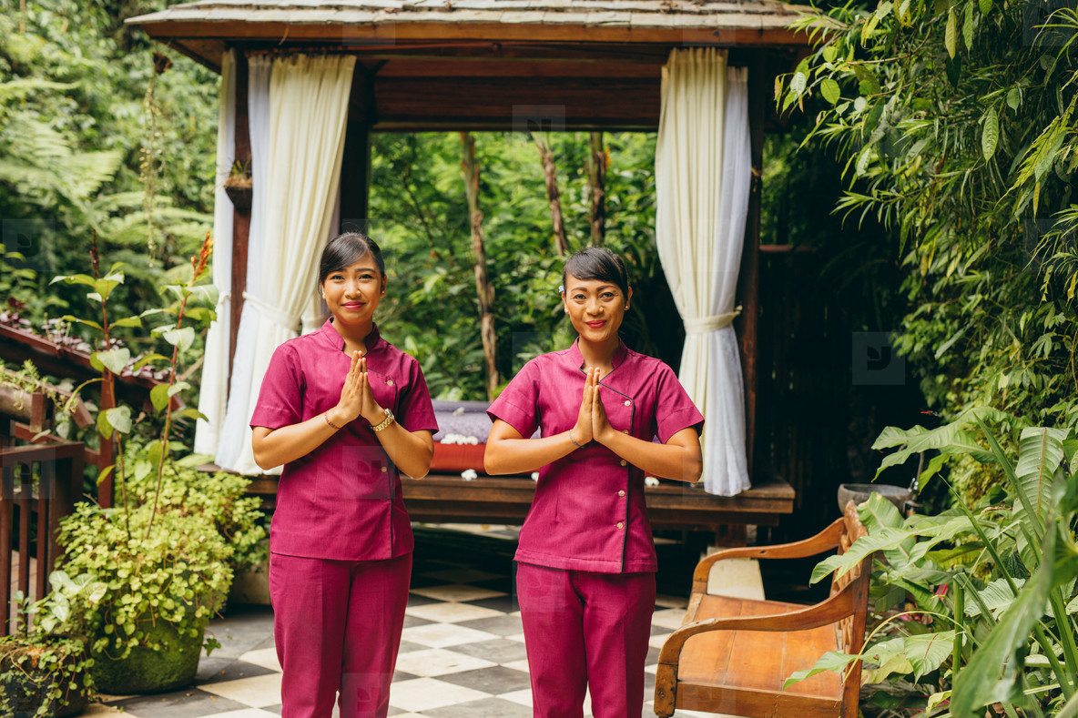 Massage therapists welcoming guest