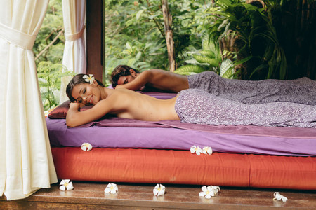 Couple lying on a massage table