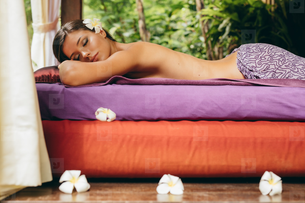 Young woman relaxing at day spa