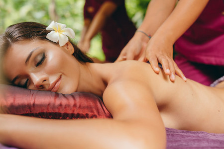 Attractive woman getting a massage at day spa